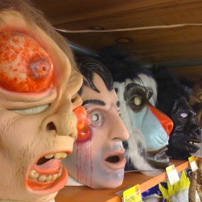 Variety of scary masks Selection inside the store for Halloween