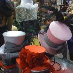 White, Silver, Orange hat on display for Halloween